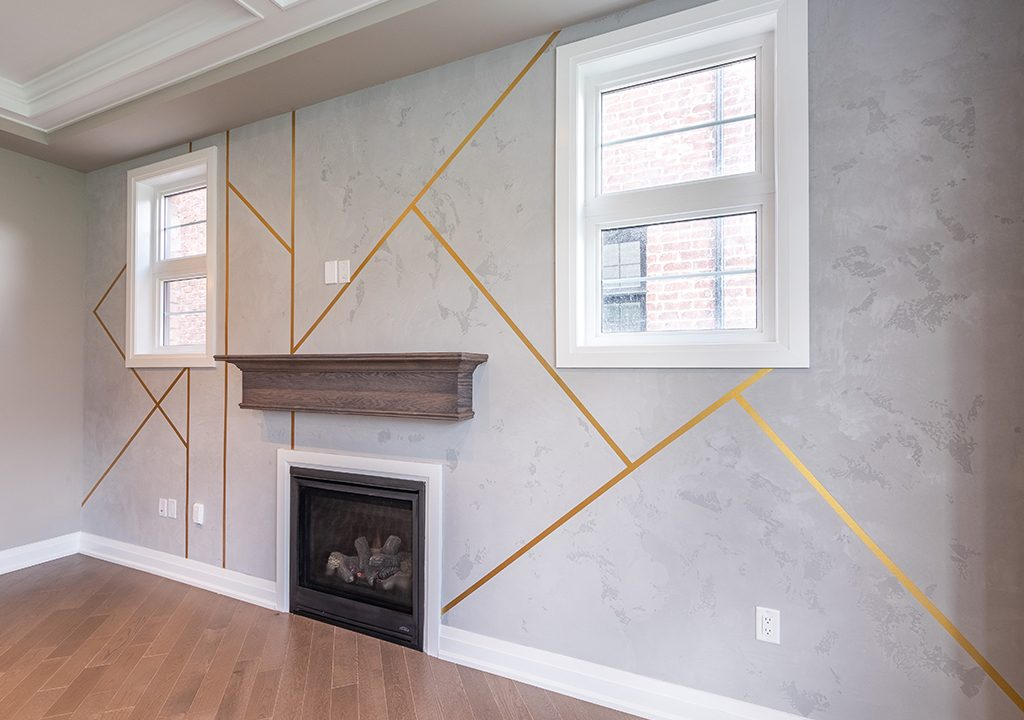 modern living room with custom wallpaper and build in fire place Aurora